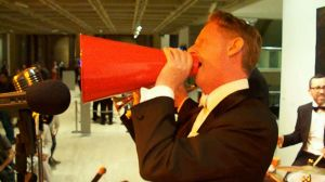 Greg Poppleton singing  into a 1920s megaphone with Bakelite Jazz at Art and About 2011, Art Gallery of NSW