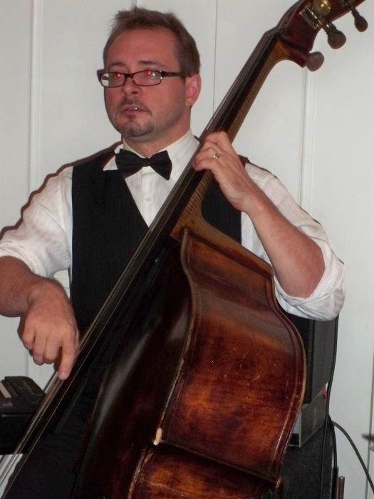Mark Harris on double bass. Where have you seen Mark before? Lah-Lah's, Monsieur Camenbert and top name bands like Greg Poppleton and the Bakelite Broadcasters - because he, too, is very, very good