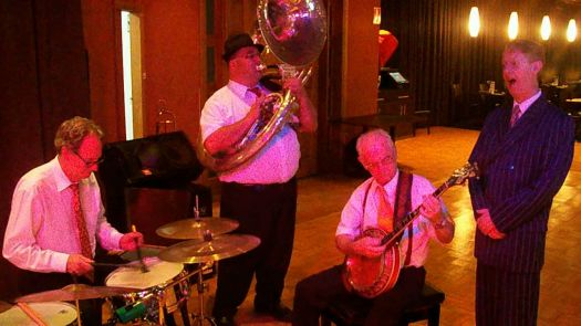 Greg Poppleton and the Bakelite Broadcasters at the Square Waffle Leumeah during Sydney's record hottest day. It hit 46C in Leumeah! In the band, Lawrie Thompson drums, Rod Herbert sousaphone and bass trombone, Grahame Conlon banjo, Greg Poppleton singer