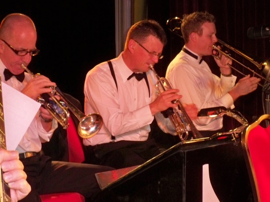 The brass section of The Lounge Bar Lotharios, Al Davey, Geoff Power (musical director) Ben Gurton