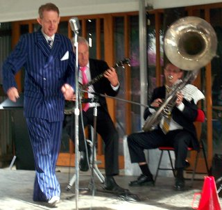 Greg Poppleton, singer in blue, with Geoff Power, sousaphone, and Paul Baker, banjo (Adam Barnard, drums, out of shot)