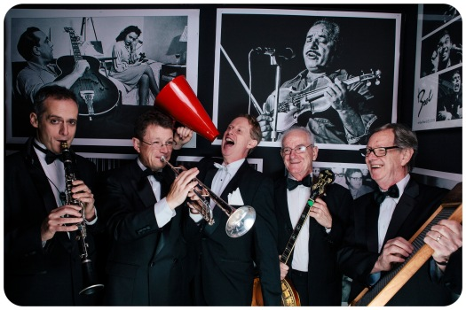 Greg Poppleton and the Bakelite Broadcasters at a 1920s theme Corporate Party. (L-R) David Horniblow (tenor sax, clarinet) Geoff Power (trumpet, sousaphone) Grahame Conlon (tenor banjo) Lawrie Thompson (drums, washboard)