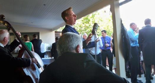 Greg Poppleton singing during pre-dinner drinks at Samantha and Tony's wedding, Margan Winery, Broke NSW