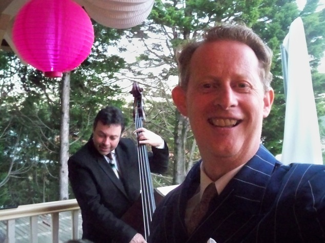 1920s-1930s style singer Greg Poppleton singing with his Bakelite Broadcasters for a 40th Birthday Party. Stan Valacos, double bass