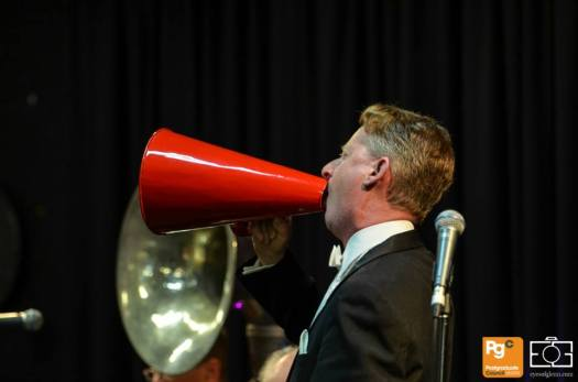 Greg Poppleton singing through the big red megaphone