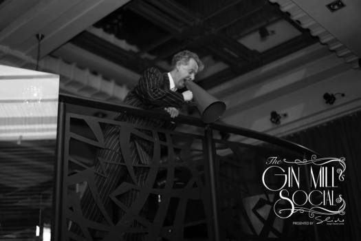 Greg Poppleton serenading guests at the Gin Mill Social from the balcony
