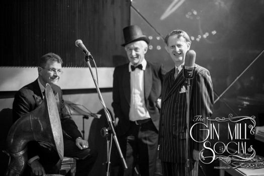 Greg Poppleton and the Bakelite Broadcasters open each Gin Mill Social with an uptempo hour of Sydney's only genuine 1920s hotcha. Greg Poppleton (1920s vocals in pinstripe suit) Paul Baker in top hat (banjo) Geoff Power (sousaphone and trumpet)