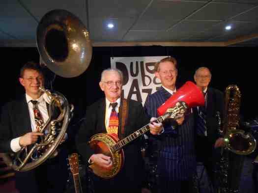 Greg Poppleton and the Bakelite Broadcasters - Dubbo Jazz Festival 2014. Playing jazz from the 1920s are (l-r) Geoff Power (sousaphone and trumpet) Grahame Conlon (banjo and guitar) Greg Poppleton (1920s singer with megaphone) Jim Elliot (Clarinet, alto and big bass saxophone)