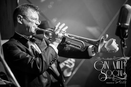 Geoff Power plays trumpet with Greg Poppleton and the Bakelite Broadcasters and using a teacup mute.