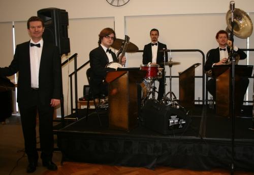 Rhythm Section - The Lounge Bar Lotharios. (l-r) Bradley Newman (piano) Michael Brady (banjo) Alex Inman-Hislop (drums) Greg Chilcott (sousaphone)