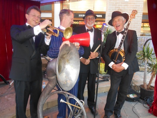 Greg Poppleton and the Bakelite Broadcasters at the Gin Mill Social, Rocks Village Bizarre, Friday 7 November 2014. We're posing for the camera just minutes before kick-off. (L-r) Geoff Power (trumpet and sousaphone) Greg Poppleton (1920s singer and megaphone) Laurie Bennett (drums) Paul Baker (banjo)