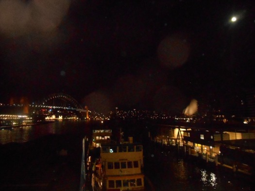 The view on the way home. A quick snap I took from Circular Quay railway using my tiny pocket camera as I waited for my train. The Sydney Harbour Bridge is on the left, The Sydney Opera House is on the right and in the middle is Sydney Cove and a ferry taking on passengers for Cremorne and Mosman.