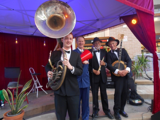 Greg Poppleton and the Bakelite Broadcasters at the Gin Mill Social, The Rocks Village Bizarre. (L-r) Greg Chilcott (sousaphone and trombone) Greg Poppleton (1920s singer and megaphone) Laurie Bennett (drums) Paul Baker (banjo).