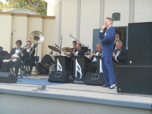 This photo of the band includes Jim Elliott (tenor sax and clarinet) just behind 1920s singer, Greg Poppleton, in the blue, double-breasted Royale.