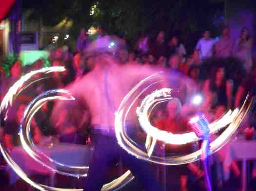 A swirl of white-hot gymnastics from Tore Munch the fire dancer amazes the Gin Mill Social crowd