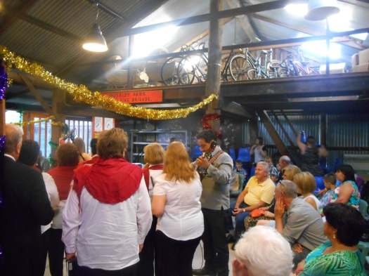 Rain brought 'Carols in the Garden' into the Machinery Shed in the Fairfield Museum. It gave 'Carols in the Garden' a real country feel. Country with jazz? It felt really natural.