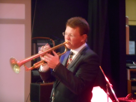 Geoff Power taking a trumpet solo on Sunday (the song and the day.)