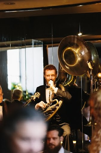 Greg Chilcott on sousaphone and trombone