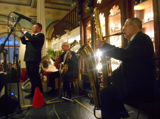 There's Jim Elliott playing the big bass saxophone with Greg Poppleton and the Bakelite Broadcasters, 2015 great Art Deco Ball. Geoff Power solos on trumpet. Grahame Conlon is playing banjo.
