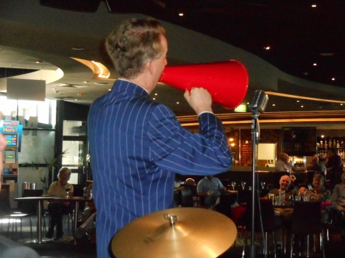 Greg Poppleton, authentic 1920s and 1930s singer, singing 'Carolina In The Morning' through a megaphone...