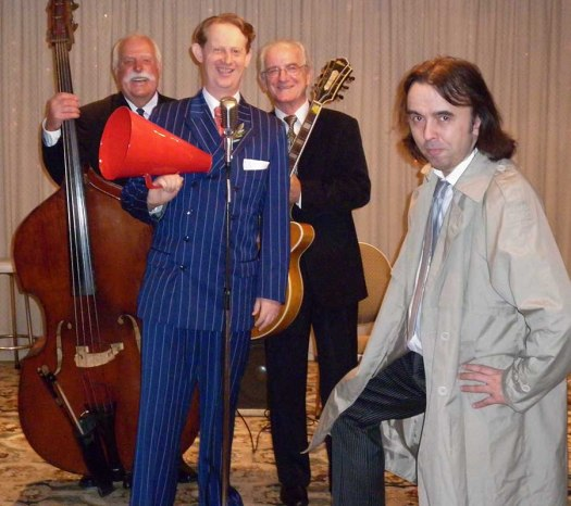 Greg Poppleton and the Bakelite Broadcasters Trio with Gary Boulter at a Murder Mystery Fun event. (L-r Darcy Wright (named by Rolling Stone as one of the world'd Top Ten jazz bassists) Greg Poppleton (authentic 1920s - 1930s dance band singer) Grahame Conlon (guitar, ex Billy Fields and Ricky May) Gary Boulter (Mr Murder Mystery Fun).