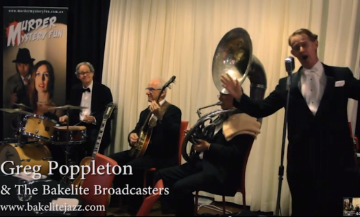 Greg Poppleton and the Bakelite Broadcasters on 'The Murder Express'. (L-r) Lawrie Thompson (d) Grahame Conlon (banjo and guitar) Geoff Power (sousaphone and trumpet) Greg Poppleton (1920s vocals including megaphone).