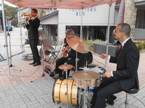 Greg Poppleton and the Bakelite Broadcasters at Thredbo Festival 2015. Greg Poppleton (taking the pic) Alex Inman-Hislop drums, Chuck Morgan banjo, guitar, uke, Greg Chicott trombone and sousaphone.