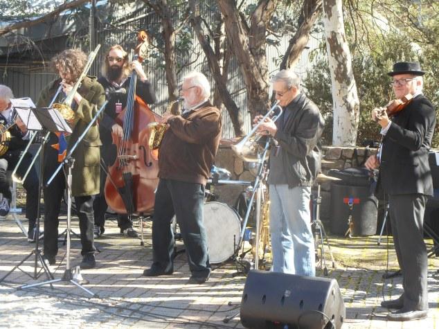 The Dixie Street All-Stars. Paul Baker (also Greg Poppleton and the Bakelite Broadcasters half in frame on the left.) Brett Iggulden soprano sax, Billy Burton trumpet, George Washingmachine violin.