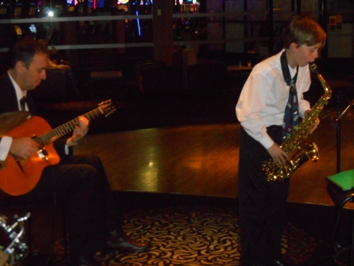 Damon Poppleton on alto sax, with Nigel Date, guitar, playing Take the A Train.
