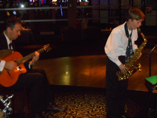 Damon Poppleton on alto sax, with Nigel Date, guitar, playing Take the A Train.