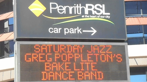 The band's old name in lights. Maybe Bakelite Dance Band is catchier than Bakelite Broadcasters?
