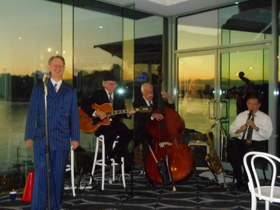 Greg Poppleton and the Bakelite Broadcasters at Sydney Rowers. Singing and playing the songs of the 1920s and 1930s are (l-r) Greg Poppleton (vocals) Grahame Conlon (g) Darcy Wright (db) Paul Furniss (cl and alto sax).
