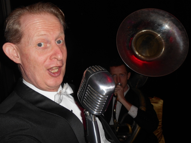 Greg Poppleton singing 1920s - 1930s jazz swing singing style has been described by eJazzNews and jazz critic Kevin Jones as 'uncannily authentic'.