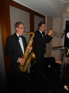 This is a clearer pic of Todd Hardy, trumpet, and Ben Jones, tenor sax doubling on clarinet. The tune was Darktown Strutters Ball.