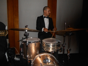 Alex Inman-Hislop is gaining a reputation as a hot, new drummer. He is very busy. He's played with Greg Poppleton and the Bakelite Broadcasters at Thredbo Jazz, Cronulla RSL, Spring Into Jazz, Glenaeon and more. Here, Alex, is wowing the wedding party with Duke Ellington's Caravan.