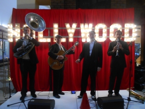 Greg Poppleton and the Bakelite Broadcasters at the Hollywood theme corporate event. L-r Greg Chilcott sousaphone doubling trombone, Grahame Conlon guitar, Greg Poppleton 1930s vocals, Chris O'Dea sax and clarinet.