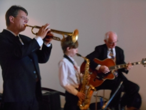 Greg Poppleton and the Bakelite Broadcasters' front line: Geoff Power trumpet. Damon Poppleton alto sax, Grahame Conlon guitar.