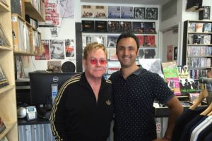 Elton John in a record shop in Newtown, Sydney. Looks unhappy because he didn't find a copy of Doin' The Charleston by Greg Poppleton and the Bakelite Broadcasters. He should have went online to Bandcamp.