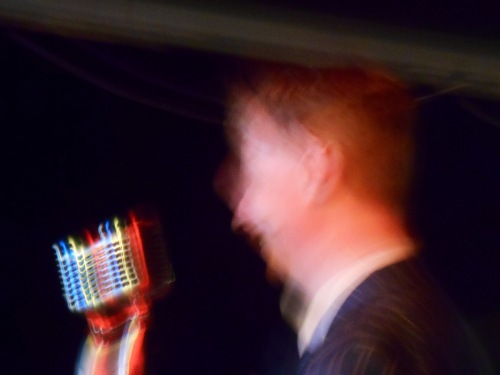 Blurry photo creates a curious strobing effect on the 1930s birdcage microphone