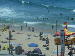 Surf, sun, sand and surf lifesavers in the distinctive yellow and red tent. Cronulla Beach from the room where Greg Poppleton and the Bakelite Broadcasters played the songs of the 1920s and 1930s for dancers.