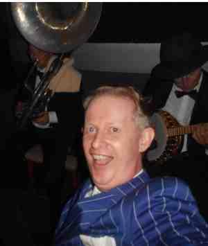 Greg Poppleton and the Bakelite Broadcasters having a wild 1920s time at the 19 february Gin Mill Social. Greg Poppleton (blue-striped suit, authentic 1920s singer) Geoff Power (sousaphone doubling trumpet) Paul Baker (banjo).