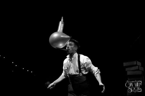 Mr Gorski balancing a bottle on a balloon on a stick sticking out of his mouth