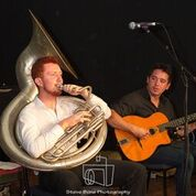 Greg Chicott sousaphone and Arthur Washington guitar with me on stage.