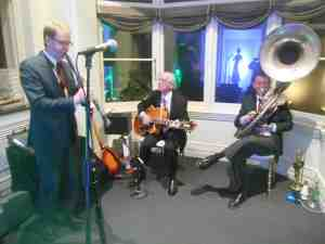 Ben Jones plays clarinet with Grahame Conlon on guitar and Geoff Power on the sousaphone. Photo by 1920s singer Greg Poppleton.