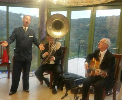 Greg Poppleton and the Bakelite Broadcasters 1920s Trio. (L-r) Greg Poppleton 1920s singer, Geoff Power sousaphone doubling trumpet, Grahame Conlon guitar doubling banjo.