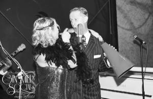 1920s singer joking with 1920s flapper