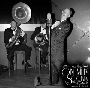 Greg Poppleton and the Bakelite Broadcasters open the Gin Mill Social with real 1920s jazz: Geoff Power (sousaphone doubling trumpet) Paul Baker (banjo) Greg Poppleton (1920s singer)