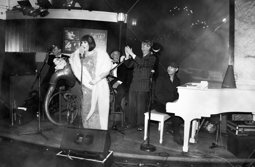 The Gin Mill Social's MC Catherine Alcorn with Jeremy Brennan at the piano and Greg Poppleton and the Bakelite Broadcasters.