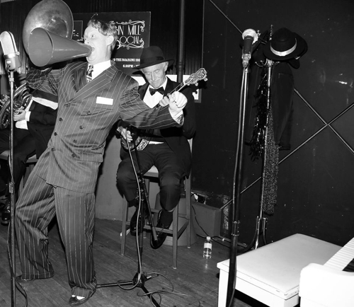 Greg Poppleton, Australia's only authentic 1920s singer with megaphone and his Bakelite Broadcasters - Paul Baker banjo, Geoff Power (obscured) sousaphone and trumpet.