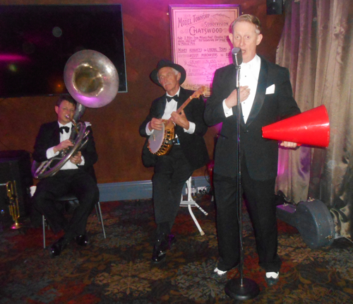 Greg Poppleton and the Bakelite Broadcasters 1920s Trio. Greg Poppleton authentic 1920s-30s singer, Paul Baker on a banjo once owned by Allan Reuss (Benny Goodman, Paul Whiteman) and Geoff Power on sousaphone doubling trumpet.
